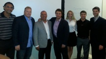 UCLA's Mark Francis and David Meltzer with part of the Sports 1 Marketing team